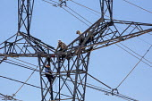 Tucson, Arizona, USA Workers up a high voltage electrical transmission pylon, Tucson Electric Power, H. Wilson Sundt Generating Station - Jim West - 19-04-2017