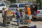 Nogales, Arizona, Prisoners working at the Borderlands Food Bank warehouse. It distributes 30 to 40 million pounds of produce each year that would otherwise end up in landfill - Jim West - 2010s,2017,America,Arizona,Arizona Department of Corrections,assisting,Bank,BANKS,Borderlands Food Bank,cities,City,CLJ,corrections,council services,distributing,distribution,excluded,exclusion,FEMALE