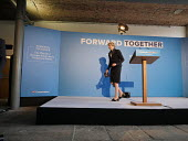 Theresa May speaking, Conservative Party manifesto launch, Dean Clough Mills, Halifax, Yorkshire, 2017 General Election campaign - Mark Pinder - 2010s,2017,campaign,campaigning,CAMPAIGNS,CONSERVATIVE,Conservative Party,conservatives,DEMOCRACY,election,elections,FEMALE,General Election,launch,manifesto,Party,people,person,persons,POL,political,