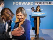 Conservative Party supporters line up to have their photographs taken on the stage set after Theresa May, Conservative Party manifesto launch, Dean Clough Mills, Halifax, Yorkshire, 2017 General Elect... - Mark Pinder - 2010s,2017,adult,adults,babies,baby,campaign,campaigning,CAMPAIGNS,CHILD,CHILDHOOD,CHILDREN,CONSERVATIVE,Conservative Party,conservatives,DEMOCRACY,EARLY YEARS,election,elections,families,family,FEMAL