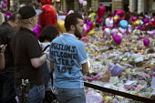T-shirt Muslims Welcome Losers Not, Flowers, candles, balloons and other tributes to the victims of the Manchester Arena terrorist bomb, St Anns Square, Manchester, UK - Paul Herrmann - .,2010s,2017,activist,activists,attack,attacking,attacks,balloon,balloons,BAME,BAMEs,Black,Black and White,BME,bmes,bomb,bombing,bombings,bombs,bouquet,bunch of,CAMPAIGNING,CAMPAIGNS,candles,COMMEMORA