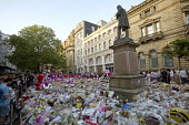 Flowers, candles, balloons and other tributes to the victims of the Manchester Arena terrorist bomb, St Anns Square, Manchester, UK - Paul Herrmann - .,2010s,2017,activist,activists,attack,attacking,attacks,balloon,balloons,bomb,bombing,bombings,bombs,bouquet,bunch of,CAMPAIGN,campaigner,campaigners,CAMPAIGNING,CAMPAIGNS,candles,COMMEMORATE,COMMEMO