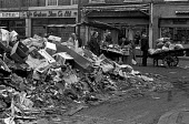 Council workers pay strike, with rubbish piled up at a street market, Tower Hamlets, East London 1970 - NLA - 27-10-1970