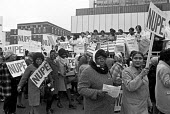 Hospital ancillary workers protest at St Thomas Hospital against low pay and Govenment policy of wage restraint, London 1972 - NLA - 1970s,1972,activist,activists,against,ancillary workers,Asian,Asians,BAME,BAMEs,Black,Black and White,BME,bmes,CAMPAIGNING,CAMPAIGNS,DEMONSTRATION,diversity,EARNINGS,ethnic,ethnicity,FEMALE,Health Wor