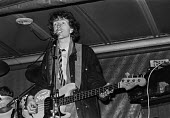 Singer songwriter Tom Robinson (R) playing at an Amnesty International candle lighting benefit concert 1978 - NLA - 1970s,1978,Amnesty International,banner,banners,celebrities,celebrity,concert,concerts,guitar,lighting,male,man,melody,men,music,MUSICAL,musical instrument,musical instruments,musician,musicians,peopl
