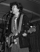 Singer songwriter Tom Robinson (R) playing at an Amnesty International candle lighting benefit concert 1978 - NLA - 1970s,1978,Amnesty Intenational,Amnesty International,banner,banners,celebrities,celebrity,concert,concerts,guitar,lighting,male,man,melody,men,music,MUSICAL,musical instrument,musical instruments,mus
