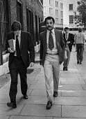 Boxer John Conteh leaving the High Court during his court case in a dispute over contract with the Boxing Board of Control, London 1979 - NLA - 1970s,1979,BAME,BAMEs,Black,BME,bmes,boxer,boxers,Boxing,clj,Court,court case,dispute,diversity,ethnic,ethnicity,High Court,John Conteh,law,lawyer,lawyers,leaving,legal,legal process,London,male,man,m