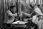 Sammy Davis Junior book signing copies of his book Hollywood in a Suitcase, Selfridges store, Oxford Street, London 1980 - NLA - 1980,1980s,ACE,ACTING,Actor,actors,american,americans,Arts,author,authors,BAME,BAMEs,Black,BME,bmes,book,book signing,books,celebrities,celebrity,Culture,DANCE,dancer,dancers,DANCING,diversity,ethnic,