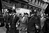 Irish minister for foreign affairs Patrick Hillery being escorted by police past a British troops out of Northern Ireland protest, having met Reginald Maudling, home secretary, Downing Street, London... - Peter Arkell - 12-08-1971
