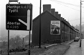 Road sign to Aberfan, South Wales, where 116 children and 28 adults were killed when a coal tip above the village collapsed and engulfed Pantglas Junior School 1971 - Peter Arkell - 1970s,1971,Aberfan,Aberfan disaster,accident,accidental,accidents,coal,Coal Industry,Coal Mine,coalfield,coalindustry,collieries,colliery,DIA,Disaster,disasters,highway,house,houses,incident,incidents