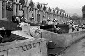 Aberfan disaster, South Wales. White arches in Bryntaf Cemetery, Aberfan mark the graves of the 116 children killed in the disaster, when a coal tip collapsed and engulfed a school in 1966 - Peter Arkell - 16-10-1971