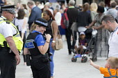 PCSO patroling Nottingham city centre, Nottinghamshire - John Harris - 2010s,2017,bought,boy,boys,buying,child,CHILDHOOD,children,CLJ,commodities,commodity,community policing,consumer,consumers,customer,customers,DAD,DADDIES,DADDY,DADS,EMOTION,EMOTIONS,families,family,fa