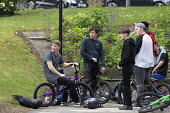 Teenagers, BMX bikes and helmets, Nottingham - John Harris - 2010s,2017,adolescence,adolescent,adolescents,bicycle,bicycles,BICYCLING,Bicyclist,Bicyclists,BIKE,BIKES,boy,boys,child,CHILDHOOD,children,cycle,cycles,cycling,Cyclist,Cyclists,enthusiast,enthusiasts,
