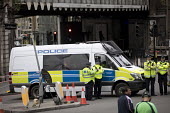 London Bridge site of the terrorist attack, London. - Jess Hurd - 2010s,2017,adult,adults,attack,attacking,attacks,Bridge,cities,City,CLJ,Crime,force,London,London Bridge,metropolitan police service,OFFICER,officers,police,Police Officer,Police Van,policeman,policem