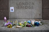 Flowers left at London Bridge site of the terrorist attack, London. - Jess Hurd - 05-06-2017