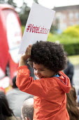 Jeremy Corbyn Labour Party rally on the last day of campaigning before the General Election, Harrow, London - Jess Hurd - 2010s,2017,BAME,BAMEs,Black,BME,bmes,boy,boys,campaign,campaigning,CAMPAIGNS,child,CHILDHOOD,children,cities,City,DEMOCRACY,diversity,ELECTION,elections,ethnic,ethnicity,General Election,Harrow,Jeremy