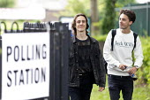 Young first time voters leaving a Polling Station having voted for the Labour Party, General Election, Stratford-upon-Avon, Warwickshire - John Harris - 08-06-2017