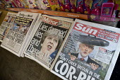 Front page headlines in a newsagents shop, Theresa May in The Mirror, Jeremy Corbyn in The Sun - John Harris - 2010s,2017,bias,buy,buyer,buyers,buying,DEMOCRACY,ELECTION,elections,General Election,Mirror,News Corporation,newsagent,newsagents,newspaper,newspapers,paper,POL,political,POLITICIAN,POLITICIANS,Polit