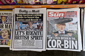 Front page headlines in a newsagents shop, Theresa May in The Daily Mail, Jeremy Corbyn in The Sun - John Harris - 2010s,2017,bias,buy,buyer,buyers,buying,DEMOCRACY,ELECTION,elections,General Election,Mail,News Corporation,newsagent,newsagents,newspaper,newspapers,paper,POL,political,POLITICIAN,POLITICIANS,Politic