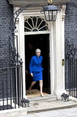 Theresa May leaving No 10 Downing Street to have an audience with the Queen after the General Election Hung Parliament result, London - Jess Hurd - 2010s,2017,audience,AUDIENCES,Conservative,Conservative Party,conservatives,DEMOCRACY,Downing Street,ELECTION,elections,FEMALE,General Election,Government,Hung Parliament,leaving,London,Minority,no 10