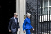 Theresa May leaving No 10 Downing Street to have an audience with the Queen after the General Election Hung Parliament result, London - Jess Hurd - 2010s,2017,audience,AUDIENCES,Conservative,Conservative Party,conservatives,DEMOCRACY,Downing Street,ELECTION,elections,FEMALE,General Election,Government,Hung Parliament,leaving,London,male,man,men,M