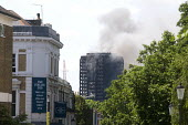 Grenfell Tower Fire. View of Grenfell Tower from about half a mile away as smoke can be seen still smouldering a full 12 hours after the raging inferno that engulfed the West London tower block result... - Stefano Cagnoni - 14-06-2017