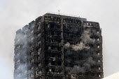 Grenfell Tower Fire. Smoke still smouldering a full 12 hours after the raging inferno that engulfed the West London tower block resulting in the loss of many lives - Stefano Cagnoni - 14-06-2017