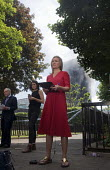 Grenfell Tower Fire. BBC TV News at One report led by Sophie Raworth as smoke still smoulders behind her a full 12 hours after the raging inferno that engulfed the West London tower block resulting in... - Stefano Cagnoni - 2010s,2017,accident,accidental,accidents,BBC,BBC TV,blocks,broadcast,broadcaster,broadcasting,building,buildings,burn,burning,BURNS,burnt out,cities,City,communicating,communication,Council Housing,Co