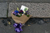 Grenfell Tower Fire. Flowers in memory of the victims laid amongst the ash that fell from the Grenfell Tower fire that engulfed the West London tower block overnight. The note reads Love and prayers t... - Stefano Cagnoni - 14-06-2017