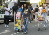 Grenfell Tower Fire. Local residents bring donations to the Latymer Community Church Centre in West London just a few hundred metres from Grenfell Tower to help victims of the disaster many of whom lo... - Stefano Cagnoni - 2010s,2017,accident,accidental,accidents,aid,assistance,assisting,BAME,BAMEs,Black,blocks,BME,bmes,Church,churches,cities,City,communities,Community,Council Housing,Council Housing,dead,death,deaths,D