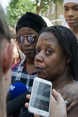 Grenfell Tower Fire. Family and friends support Aalya Moses a resident on the fourth floor of Grenfell Tower as she tells news reporters how she made her escape from the burning building which claimed... - Stefano Cagnoni - 2010s,2017,Aalya Moses,accident,accidental,accidents,BAME,BAMEs,black,BME,bmes,building,BUILDINGS,BURN,burning,BURNS,cities,City,Council Housing,Council Housing,dead,death,deaths,DIA,died,disaster,DIS