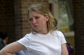 Grenfell Tower Fire. Young woman deeply upset and almost in tears waiting opposite the makeshift evacuation centre at Rugby Portobello Trust for news of victims of the fire that engulfed the West Lond... - Stefano Cagnoni - 14-06-2017