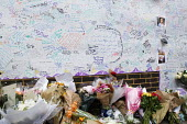 Wall of condolence a few hundred metres from the Grenfell Tower fire filled with messages of love and solidarity in memory of the victims of the tragedy, London - Stefano Cagnoni - 2010s,2017,accident,accidental,ACCIDENTS,anger,Belief,blocks,bouquet,bunch of,cities,City,COMMEMORATE,COMMEMORATING,commemoration,COMMEMORATIONS,commemorative,condolence,conviction,Council Housing,Cou