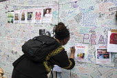Wall of condolence a few hundred metres from the Grenfell Tower fire filled with messages of love and solidarity in memory of the victims of the tragedy, London - Stefano Cagnoni - 2010s,2017,accident,accidental,ACCIDENTS,anger,BAME,BAMEs,Belief,Black,blocks,BME,bmes,bouquet,cities,City,COMMEMORATE,COMMEMORATING,commemoration,COMMEMORATIONS,commemorative,condolence,conviction,Co
