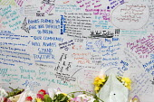 Wall of condolence a few hundred metres from the Grenfell Tower fire filled with messages of love and solidarity in memory of the victims of the tragedy, London - Stefano Cagnoni - 2010s,2017,accident,accidental,ACCIDENTS,anger,blocks,bouquet,bunch of,cities,City,COMMEMORATE,COMMEMORATING,commemoration,COMMEMORATIONS,commemorative,condolence,Council Housing,Council Housing,death