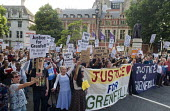 Grenfell Tower Fire. Justice For Grenfell march to Downing Street in protest at the injustice of lives lost in the tragedy, London - Stefano Cagnoni - 2010s,2017,activist,activists,against,age,ageing population,anger,angry,BAME,BAMEs,Black,Black and White,blocks,BME,bmes,CAMPAIGN,campaigner,campaigners,CAMPAIGNING,CAMPAIGNS,cities,City,Council Housi