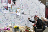 Wall of condolence a few hundred metres from the Grenfell Tower fire filled with messages of love and solidarity in memory of the victims of the tragedy, London - Stefano Cagnoni - 2010s,2017,accident,accidental,ACCIDENTS,anger,BAME,BAMEs,Belief,Black,blocks,BME,bmes,bouquet,bunch of,cities,City,COMMEMORATE,COMMEMORATING,commemoration,COMMEMORATIONS,commemorative,condolence,conv