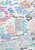 Wall of condolence a few hundred metres from the Grenfell Tower fire filled with messages of love and solidarity in memory of the victims of the tragedy, London - Stefano Cagnoni - 2010s,2017,accident,accidental,ACCIDENTS,anger,blocks,bouquet,cities,City,COMMEMORATE,COMMEMORATING,commemoration,COMMEMORATIONS,commemorative,condolence,Council Housing,Council Housing,death,deaths,D