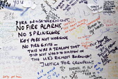 Wall of condolence a few hundred metres from the Grenfell Tower fire filled with messages of love and solidarity in memory of the victims of the tragedy, London. Listing the lack of alarms, sprinklers... - Stefano Cagnoni - 2010s,2017,accident,accidental,ACCIDENTS,anger,blocks,bouquet,cities,City,COMMEMORATE,COMMEMORATING,commemoration,COMMEMORATIONS,commemorative,condolence,Council Housing,Council Housing,death,deaths,D
