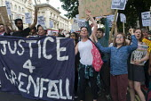 Grenfell Tower Fire. Justice For Grenfell march to Downing Street in protest at the injustice of lives lost in the tragedy, London - Stefano Cagnoni - 2010s,2017,activist,activists,anger,angry,BAME,BAMEs,Black,Black and White,blocks,BME,bmes,CAMPAIGNING,CAMPAIGNS,cities,City,Council Housing,Council Housing,DCLG,death,deaths,DEMONSTRATING,demonstrati