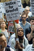 Grenfell Tower Fire. Justice For Grenfell rally outside the Department for Communities and Local Government, Westminster in protest at the injustice of lives lost in the tragedy, London - Stefano Cagnoni - 2010s,2017,activist,activists,BAME,BAMEs,Black,Black and White,blocks,BME,bmes,CAMPAIGNING,CAMPAIGNS,cities,City,Council Housing,Council Housing,DCLG,death,deaths,DEMONSTRATING,demonstration,Departmen