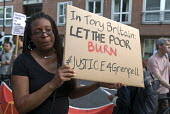 Grenfell Tower Fire. Justice For Grenfell rally outside the Department for Communities and Local Government, Westminster in protest at the injustice of lives lost in the tragedy, London - Stefano Cagnoni - 2010s,2017,activist,activists,Austerity Cuts,BAME,BAMEs,black,Black and White,blocks,BME,bmes,CAMPAIGNING,CAMPAIGNS,cities,City,CONSERVATIVE,Conservative Party,conservatives,Council Housing,Council Ho