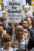 Grenfell Tower Fire. Justice For Grenfell rally outside the Department for Communities and Local Government, Westminster in protest at the injustice of lives lost in the tragedy, London - Stefano Cagnoni - 2010s,2017,activist,activists,against,BAME,BAMEs,black,Black and White,blocks,BME,bmes,CAMPAIGN,campaigner,campaigners,CAMPAIGNING,CAMPAIGNS,cities,City,Council Housing,Council Housing,DCLG,death,deat