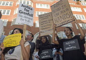 Grenfell Tower Fire. Justice For Grenfell rally outside the Department for Communities and Local Government, Westminster in protest at the injustice of lives lost in the tragedy, London - Stefano Cagnoni - 2010s,2017,activist,activists,against,BAME,BAMEs,black,Black and White,blocks,BME,bmes,CAMPAIGN,campaigner,campaigners,CAMPAIGNING,CAMPAIGNS,cities,City,corporate murder,Council Housing,Council Housin