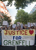 Grenfell Tower Fire. Justice For Grenfell march to Downing Street in protest at the injustice of lives lost in the tragedy, London - Stefano Cagnoni - 2010s,2017,activist,activists,against,BAME,BAMEs,Black,Black and White,blocks,BME,bmes,CAMPAIGN,campaigner,campaigners,CAMPAIGNING,CAMPAIGNS,cities,City,Council Housing,Council Housing,DCLG,death,deat