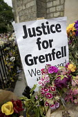 Floral tributes and missing posters for the victims Grenfell Tower Fire, West London. - Jess Hurd - 2010s,2017,accident,accidental,accidents,bouquet,bunch of,cities,City,COMMEMORATE,COMMEMORATING,commemoration,COMMEMORATIONS,commemorative,Council Housing,Council Housing,death,deaths,dia,died,disaste