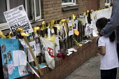 Floral tributes and the missing posters of the victims Grenfell Tower Fire, West London. - Jess Hurd - 22-06-2017