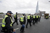Policing Unite Against Extremism, Football Lads Alliance march to lay club wreaths at London Bridge, the site of a terror attack. - Jess Hurd - 2010s,2017,activist,activists,adult,adults,Against,attack,attacking,Bridge,CAMPAIGN,campaigner,campaigners,CAMPAIGNING,CAMPAIGNS,casuals,CLJ,club,clubs,DEMONSTRATING,Demonstration,DEMONSTRATIONS,extre