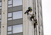 Contractors inspecting external panels on Bray Tower one of the five towers in Chalcot Estate, Camden, London, all of which have been refurbished using exterior cladding which now has to be urgently r... - Stefano Cagnoni - 27-06-2017