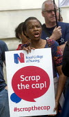RCN Nurses beginning a summer of protest against pay restraint, protest at Department of Health, London, against the government pay cap for public servants - Stefano Cagnoni - 2010s,2017,activist,activists,against,anti,austerity,Austerity Cuts,BAME,BAMEs,black,Black and White,BME,bmes,CAMPAIGNING,CAMPAIGNS,DEMONSTRATING,Demonstration,Department,diversity,EARNINGS,ethnic,eth